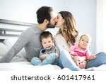 a family of four play on a... | Shutterstock . vector #601417961