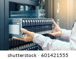 it engineer installs enclosure... | Shutterstock . vector #601421555