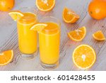 orange juice in glasses at... | Shutterstock . vector #601428455