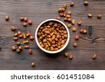 Stock photo dry dog food in bowl on wooden background top view 601451084