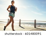 Female Runner Running Along Th...