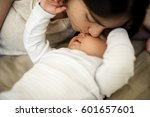 mother is taking care of her... | Shutterstock . vector #601657601