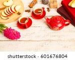 tea in red cups  apples  flower ... | Shutterstock . vector #601676804
