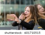young woman taking selfie with... | Shutterstock . vector #601710515