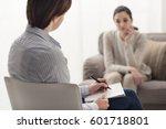 psychologist listening to her... | Shutterstock . vector #601718801