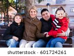 happy average family with two... | Shutterstock . vector #601724261