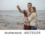 happy thoughtful couple... | Shutterstock . vector #601731155