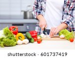 young woman cutting products on ... | Shutterstock . vector #601737419
