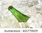 Small photo of close up green beer bottle chill in ice
