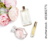 perfume bottles with flowers on ... | Shutterstock . vector #601802771