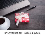 laptop computer with cup of tea ... | Shutterstock . vector #601811231