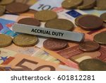 Small photo of accrual duty - the word was printed on a metal bar. the metal bar was placed on several banknotes
