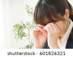 young woman with her eye dry | Shutterstock . vector #601826321