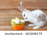 easter rabbit and a basket with ... | Shutterstock . vector #601848179