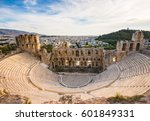Small photo of Odeon of Herodes Atticus on Acropolis hill in Athens, Greece with view on the city, sunset light and soft focus