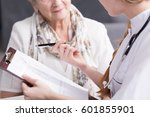 Small photo of Physician doing medical interview with elderly patient