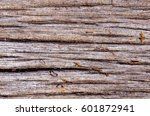 Small photo of A texture on a surface of old afzelia wood show a detail of cracked, scar, dust, stain and a lot of things on the surface