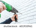 use hammer drill to drill the... | Shutterstock . vector #601933961