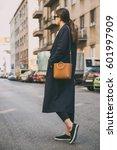 fashionable woman wearing a... | Shutterstock . vector #601997909