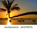 Stock photo sunset with palm and boats on tropical beach ko tao island thailand 60199876