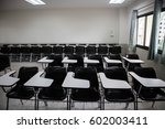 classroom with a desk stacked... | Shutterstock . vector #602003411