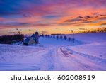 Sunset Over A Snow Covered Roa...