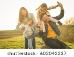 parents play with his daughters ... | Shutterstock . vector #602042237