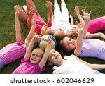 happy group of children lying... | Shutterstock . vector #602046629