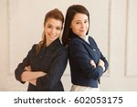 two beautiful business woman... | Shutterstock . vector #602053175