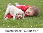 Stock photo little girl with a golden retriever puppy 60205597