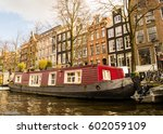 Tipycal Houseboat In Amsterdam...