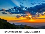 sunset clouds in sunset sky... | Shutterstock . vector #602063855