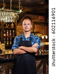 portrait of cheerful barman... | Shutterstock . vector #602116901