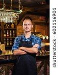 portrait of cheerful barman... | Shutterstock . vector #602116901