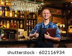 portrait of cheerful barman... | Shutterstock . vector #602116934