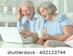 elderly couple with a laptop | Shutterstock . vector #602123744