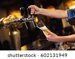 bartender pouring from tap...   Shutterstock . vector #602131949