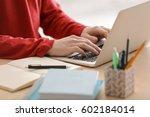 teenager working with laptop... | Shutterstock . vector #602184014