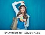 smiling woman traveler holding... | Shutterstock . vector #602197181