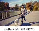 Stock photo fitness sport people pets and jogging concept happy man with labrador retriever dog running 602206907