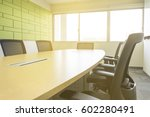Small photo of wooden table in meeting room with sound absorber sunlight from window