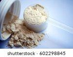 Stock photo vanilla protein powder in scoop on white background 602298845