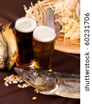 Beer and snacks set: chips, pistachio, shrimp and fish - stock photo