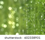 abstract green bokeh circles.... | Shutterstock . vector #602338931