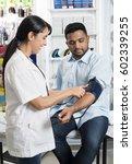 female chemist checking blood... | Shutterstock . vector #602339255