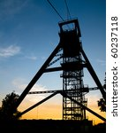 A Mine Shaft Tower At Sunset