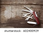 Old Swiss Knife On A Wooden...