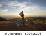 paragliding girl | Shutterstock . vector #602416205