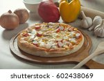 sea food pizza | Shutterstock . vector #602438069