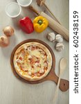 stuffing hot dog pizza | Shutterstock . vector #602438159